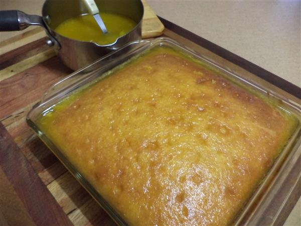 Gluten free orange drizzle cake with orange sauce